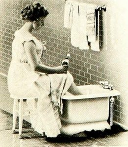 lady with feet in old-fashioned-tub